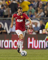 Manchester United FC defender Jonathan Evans (23) brings the ball forward. In a Herbalife World Football Challenge 2011 friendly match, Manchester United FC defeated the New England Revolution, 4-1, at Gillette Stadium on July 13, 2011.