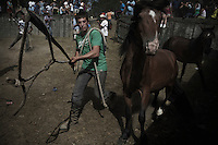 A man try to catcha horse during the Morgadanes&acute;s curro in Gondomar (Galicia on June 26, 2011. When summertime comes in Galicia (Northwest of Spain), the use of &ldquo;curro&rdquo; begins. A ritual which preserves the free and wild spirit of this region which has remained traditionally tied to nature.<br />