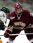 "19 January 2007: Boston College forward Dan Bertman from Calgary, AB, prepares for a faceoff during a Hockey East matchup against the University of Vermont at Gutterson Fieldhouse in Burlington, Vermont. The UVM Catamounts defeated the BC Eagles 3-2 before a record setting 50th consecutive sellout at ""the Gut""...Mandatory Photo Credit: Ed Wolfstein Photo."