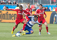 06 April 2013: FC Dallas midfielder/forward David Ferreira #10 battles for a ball with Toronto FC defender Jeremy Hall #25 and Toronto FC midfielder Jonathan Osorio #21 during an MLS game between FC Dallas and Toronto FC at BMO Field in Toronto, Ontario Canada..The game ended in a 2-2 draw..