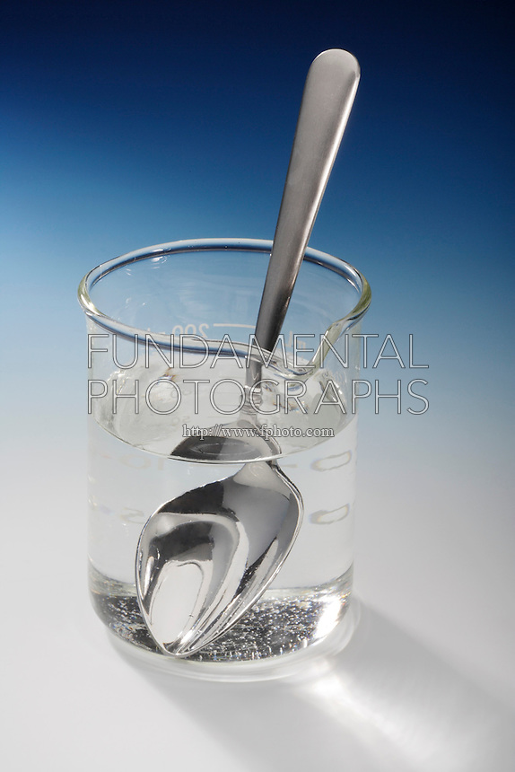 SUGAR AND WATER- MIXTURE AND SOLUTION (2 of 2)<br /> Stirring Sugar In Water<br /> Upon stirring, the sugar dissolves to form a homogeneous mixture or solution.