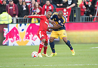Toronto, Ontario - May 17, 2014: Toronto FC forward Jermain Defoe #18 and New York Red Bulls defender Jamison Olave #4 in action during a game between the New York Red Bulls and Toronto FC at BMO Field. Toronto FC won 2-0.