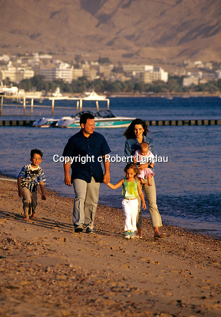 King Abdullah II and family stroll along beach near the summer pallace in Aqaba