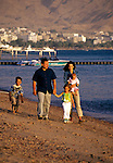 King Abdullah II and family stroll along beach near the summer pallace in Aqaba