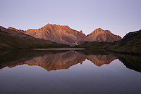 Twilight on St. Arnaud Ranges with reflections in pristine Hinapouri Tarn, Nelson Lake National Park, South Island, New Zealand, NZ