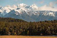 Southern Alps with Mt. Tasman and Aoraki, Mt. Cook from Three Mile beach near Okarito, Westland Tai Poutini National Park, West Coast, UNESCO Wolrd Heritage Area, New Zealand, NZ