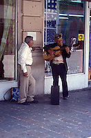 Elderly street musicians with lovers, city of Chihuahua, Mexico