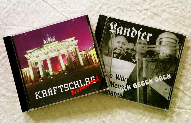 Neonazi Musik-CD's.<br /> Die oftmals in Osteuropa produzierten CD's werden in der Skinhead- und Neonazi-Szene zu horrenden Preisen Preisen verkauft und bescheren den Plattenfirmen phaenomenale Umsaetze. Die CD's enthalten z.T. indizierte und verbotene Musikstuecke.<br /> Hier: &quot;Kraftschlag - Nordwind; &quot;Landser - Rock gegen Oben&quot;, beide aus Deutschland.<br /> 19.9.2000<br /> Copyright: Christian-Ditsch.de<br /> [Inhaltsveraendernde Manipulation des Fotos nur nach ausdruecklicher Genehmigung des Fotografen. Vereinbarungen ueber Abtretung von Persoenlichkeitsrechten/Model Release der abgebildeten Person/Personen liegen nicht vor. NO MODEL RELEASE! Nur fuer Redaktionelle Zwecke. Don't publish without copyright Christian-Ditsch.de, Veroeffentlichung nur mit Fotografennennung, sowie gegen Honorar, MwSt. und Beleg. Konto: I N G - D i B a, IBAN DE58500105175400192269, BIC INGDDEFFXXX, Kontakt: post@christian-ditsch.de<br /> Bei der Bearbeitung der Dateiinformationen darf die Urheberkennzeichnung in den EXIF- und  IPTC-Daten nicht entfernt werden, diese sind in digitalen Medien nach &sect;95c UrhG rechtlich gesch&uuml;tzt. Der Urhebervermerk wird gemaess &sect;13 UrhG verlangt.]