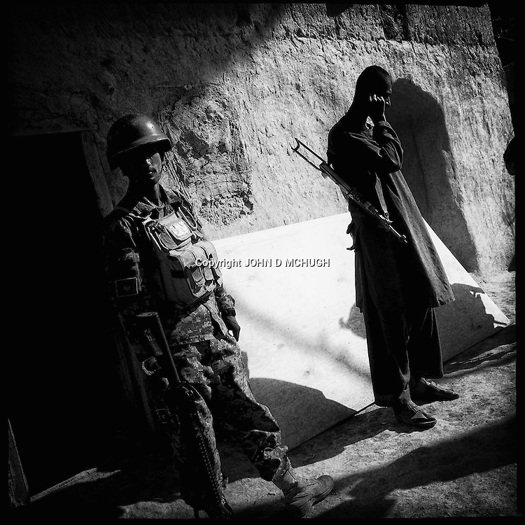 Afghan Local Police, based in the village of Pay-E Moluk prepare to go on patrol with US troops from 1-38 Infantry and Afghan National Army soldiers, 30 April 2013. The patrol would turn into a five our firefight with the Taliban. (John D McHugh)