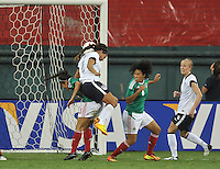Sydney Leroux (2) of the USWNT heads the ball against Bianca Sierra (3) of Mexico to score one of her 4 goals. The USWNT defeated Mexico 7-0 during an international friendly, at RFK Stadium, Tuesday September 3, 2013.