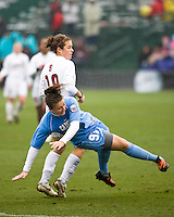 Stanford forward Kelley O'Hara (19) and North Carolina midfielder Maria Lubrano (91). North Carolina defeated Stanford 1-0 to win the 2009 NCAA Women's College Cup at the Aggie Soccer Stadium in College Station, TX on December 6, 2009.