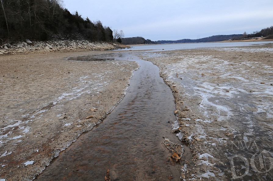 NWA Democrat-Gazette/FLIP PUTTHOFF <br /> A creek flows into Beaver Lake Jan. 7 2017 in an area that is usually a cove when the lake is higher. The lowest levels of Beaver Lake typically occur during winter.