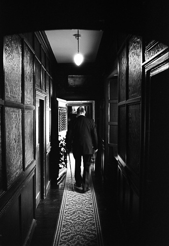 Old Man in Corridor, Oxburgh Hall – Black & White Film Photography