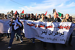 Palestinian protester shout slogans during a demonstration against the Prawer plan at the gate of the Beit El settlement, near Ramallah, on November 30, 2013. The so-called Prawer-Begin Bill calls for the relocation of 30,000-40,000 Bedouin, the demolition of about 40 villages and the confiscation of more than 700,000 dunums (70,000 hectares) of land in the Negev. Photo by Issam Rimawi