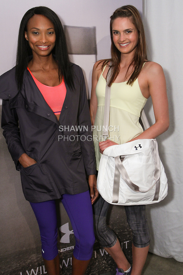 "Models pose in athletic gear during the Under Armour, ""I will what I want"" global women's campaign launch, on July 31, 2014, in New York City."