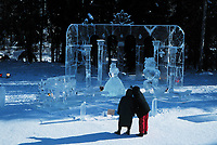 Tourist view Beauty and the Beast ice sculpture at the World Ice Sculpting competition, Fairbanks, Alaska.