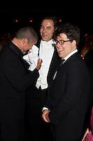 George Michael, David Walliams and Michael McIntyre enjoying a laugh at Elton John's White Tie and Tiara Ball