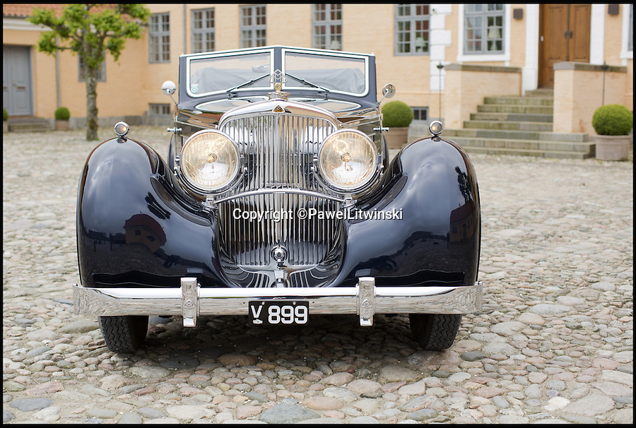 BNPS.co.uk (01202 558833)<br /> Pic: PawelLitwinski/Bonhams/BNPS  <br /> <br /> Airship Doplomacy...Monster Maybach Zeppelin a present from the Fuhrer.<br /> <br /> A luxury car that Nazi tyrant Adolf Hitler gifted to an Indian ruler in a failed bid to 'buy' his favour in the run-up to World War II has emerged for sale for &pound;2.3 million.<br /> <br /> Hitler gave the plush Maybach motor to Maharaja Bhupinder Singh of Patiala in 1935, a year after he had declared himself Fuhrer of Germany.<br /> <br /> The flamboyant Maharaja, one of the most powerful and influential people in India, had travelled to Germany and befriended Hitler during an unlikely meeting between the two in Berlin.<br /> <br /> When the Maharajah left, Hitler shipped him a white Maybach DS8 Zeppelin, one of the most luxurious and advanced cars of its time and powered by the same 7.9-litre 12-cylinder engine used in Zeppelin airships.<br /> <br /> Now dark blue, the rare car is being sold by Danish collector Henrik Frederiksen in a Bonhams auction of more than 50 classic motors.
