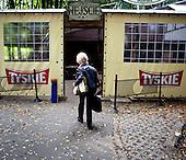 WARSAW, POLAND, NOVEMBER 2011:.Wika Szmyt, a 74 year old DJ entering Bolek club, where she  is running a disco..Wika is famous in Poland for being the oldest DJ. Twice a week she runs discos at the Bolek club in Warsaw, frequented mainly by the pensioners..(Photo by Piotr Malecki/Napo Images)..WARSZAWA, LISTOPAD 2011:.DJ Wika wchodzi do Klubu Bolek, Pola Mokotowskie. Tu DJ Wika prowadzi dyskoteke w klubie Bolek. Wika Szmyt, 74-letnia DJ jest znana jako najstarsza didzejka w Polsce. Dwa razy w tygodniu prowadzi dyskoteki w klubie Bolek, na ktore przychodza glownie emeryci..Fot: Piotr Malecki/Napo Images.***ZAKAZ PUBLIKACJI W TABLOIDACH I PORTALACH PLOTKARSKICH*** .*** Zdjecie moze byc uzyte w prasie, gdy sposob jego wykorzystania oraz podpis nie obrazaja osob znajdujacych sie na fotografii ***.