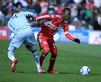 Beaten Sporting KC midfielder Craig Rocastle (4) grabs the jersey of Chicago Fire midfielder Patrick Nyarko (14).  The Chicago Fire defeated Sporting KC 3-2 at Toyota Park in Bridgeview, IL on March 27, 2011.