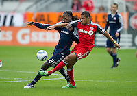 22 October 2011: New England Revolution midfielder Shalrie Joseph #21 and Toronto FC forward Ryan Johnson #9 in action during a game between the New England Revolution and Toronto FC at BMO Field in Toronto.