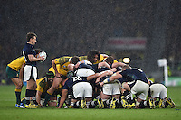 A scrum forms in the pouring rain. Rugby World Cup Quarter Final between Australia and Scotland on October 18, 2015 at Twickenham Stadium in London, England. Photo by: Patrick Khachfe / Onside Images