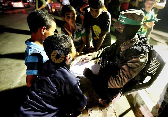 Palestinians boys wait to register their names in the summer camps organized by the Izzedine al-Qassam brigades, loyal to Hamas movement, in Gaza city on June 29, 2015. Photo by Nidal Alwaheidi