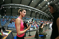 Almudena Cid of Spain takes break from photographing to talk with friend Esther Teijeira at 2007 Portimao World Cup of Rhythmic Gymnastics on April 28, 2006.  (Photo by Tom Theobald)..Photo note: Esther loaned her camera to Almu.  Almu knows the moments and is natural photographer:)