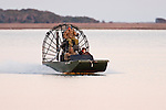 Duck Hunters in air boat, Texas gulf coast, winter