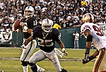 Oakland Raiders running back Charlie Garner (25) blocks for quarterback Rich Gannon (12) on Sunday, November 3, 2002, in Oakland, California. The 49ers defeated the Raiders 23-20 in an overtime game.