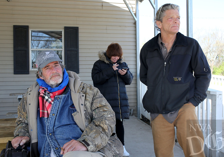 NWA Democrat-Gazette/DAVID GOTTSCHALK  Alvin Davis (from left), speaks with Stephanie Regan, both residents of the Walker Family Residential Community, and Trey Stanley, homeless, Thursday, April 6, 2017, at the 7 Hills Homeless Center about the creation of the Independent Workshop, Homeless Workshop, in Fayetteville. Regan and Stanley would be foremans at the shop that would manufacture, produce and sell items by the homeless. The shop is in it's planning stages and would help individuals become self sufficient by gaining marketable skills.