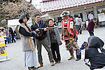 Visitors pose with a Spencer rifle and a guide in samurai garb inside the grounds of Tsuruga-jo Castle in Aizu-wakamatsu City, Fukushima Prefecture, Japan on 01 May 2013.  Photographer: Rob Gilhooly