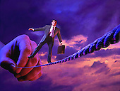 Business man walking tightrope