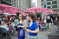 Foodies enjoy the offerings at the Madison Square Eats outdoor market in New York on Sunday, May 27, 2012. The month-long temporary food fair, in Worth Square by Madison Square park,  brings an assortment of restaurants providing an outdoor dining experience attracting food lovers and the after-work crowd. (© Richard B. Levine)