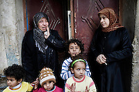 SYRIA - Al Qsair. Syrian women and children are seen as the funeral of a member of  the Free Syrian Army, killed in Al Qsair, is passing in front of their house on February 9, 2012. ALESSIO ROMENZI