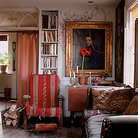 In the downstairs parlour a late-Victorian William Morris chair covered with an Indian blanket has been placed beneath an 1837 portrait by Joseph Greenleaf Cole