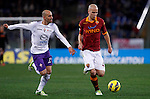 Calcio, Serie A: Roma vs Fiorentina. Roma, stadio Olimpico, 8 dicembre 2012..AS Roma midfielder Michael Bradley, of the United States, is chased by Fiorentina midfielder Borja Valero, of Spain, left, during the Italian Serie A football match between AS Roma and Fiorentina at Rome's Olympic stadium, 8 december 2012..UPDATE IMAGES PRESS/Isabella Bonotto