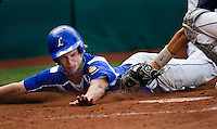 "The Laurel Dodgers #33 Brian Flotkoetter attempts to steal home, but is tagged out on the play against the Kennewick Junior Bandits in the championship game of the American Legion Northwest Class ""A"" Regional Tournament.The Bandits took first place with a score of 7-6 after 9 innings of play at Kearns Gates Field in Kearn Utah Tuesday, Aug. 11, 2009. August Miller"
