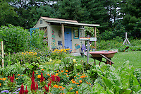 Garden shed at the community garden with colorful signs, Yarmouth ME
