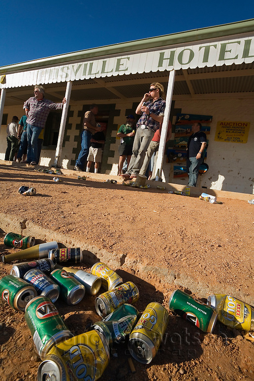 Empty beer cans outside the Birdsville Hotel during the annual Birdsville horse races.  Birdsville, Queensland, Australia