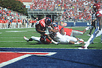 Ole Miss' Jeff Scott (3) is tackled by Arkansas linebacker Alonzo Highsmith (45), who was called for a facemask penalty, at Vaught-Hemingway Stadium in Oxford, Miss. on Saturday, October 22, 2011. .