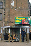 Two men stand beneath a shanty lean-to in Manhattan's Lower East Side in the 1980s.
