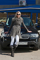 Krasnodar, Russia, 17/03/2009..World champion heptathlete Tatyana Chernova with the BMW X3 given to her by Russian President Dmitri Medvedev. Chernova, who won bronze in the Beijing Olympic Games, is tipped for gold in London.