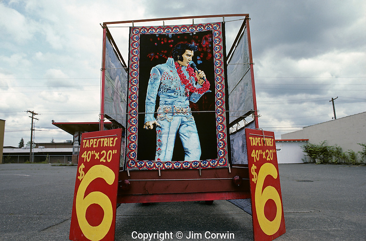 Elvis Presley tapestry (painting) being sold from a trailer in an empty parking lot along