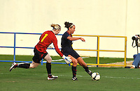 Lauren Cheney shoots around Swedish goalkeeper Hedvig Lindahl for the first of her two goals.  The USA was victorious over Sweden 2-0 in Ferreiras on March 1, 2010 at the Algarve Cup.