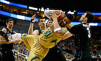 PITTSBURGH, PA - MARCH 21: Zach Auguste #30 of the Notre Dame Fighting Irish and Alex Barlow #3 of the Butler Bulldogs go after the ball in the second half during the third round of the 2015 NCAA Men's Basketball Tournament at Consol Energy Center on March 21, 2015 in Pittsburgh, Pennsylvania.  (Photo by Jared Wickerham/Getty Images)