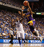 LSU guard Anthony Hickey goes for a lay-up as UK guard Archie Goodwin attempts to block during the first half of the men's basketball game vs. LSU at Rupp Arena, in Lexington, Ky., on Saturday, January 26, 2013. Photo by Genevieve Adams  | Staff.