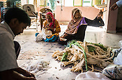Woman workers seen sowing fabric at a batik workshop in Jaipur, Rajasthan, India.