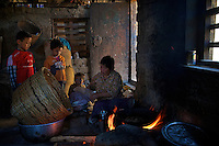 Women in her house cooking in the Traditional Village of Sopsokha, Punakha District, Bhutan