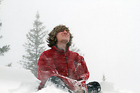 Jackson Hole Zen.  Teenager in a snowstorm  on Teton Pass in Jackson Hole Wyoming.